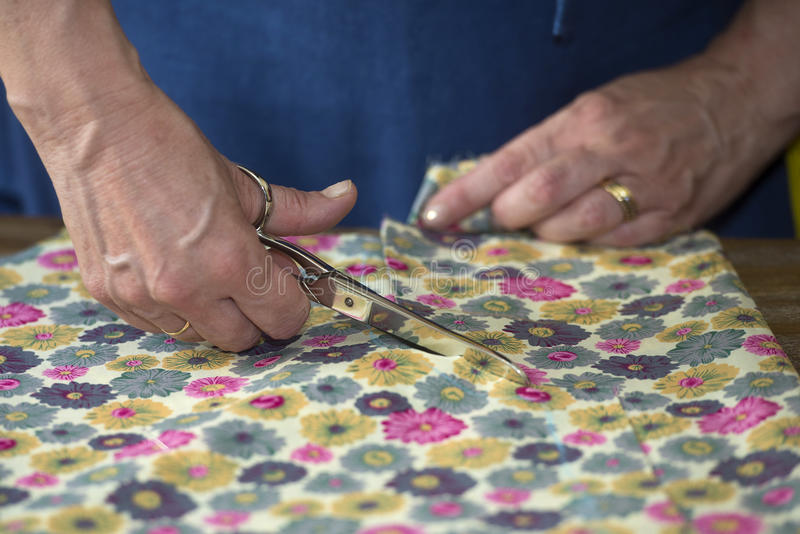 Closeup of hands of seamstress. Working royalty free stock photo