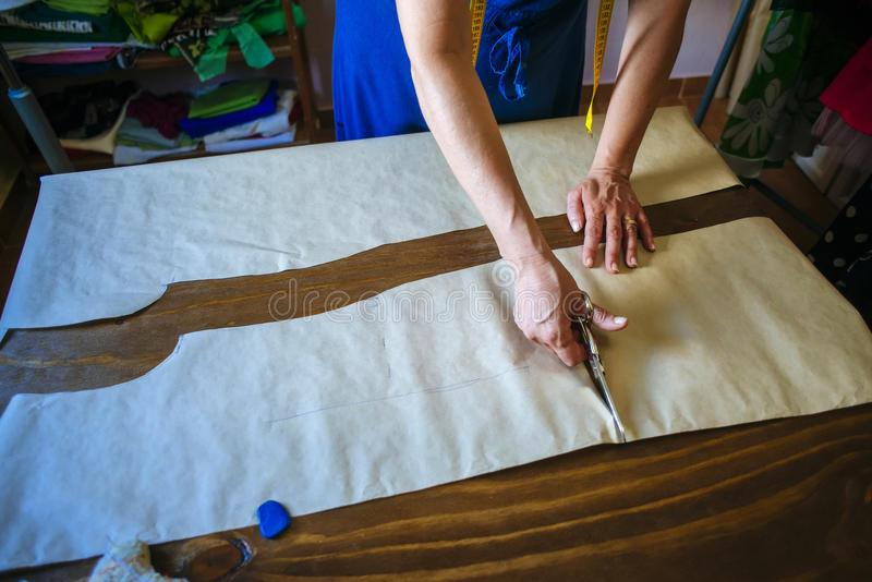 Closeup of hands of seamstress working. In the tailoring royalty free stock photos