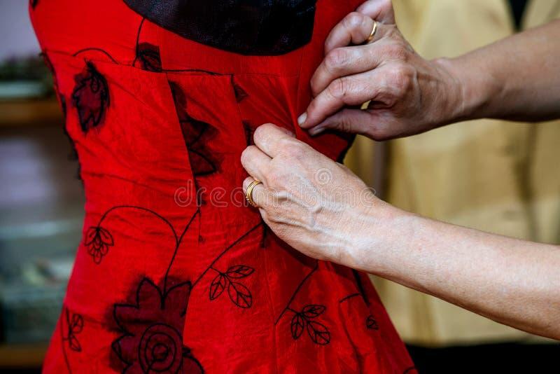 Closeup of hands seamstress working. Closeup of hands of seamstress working in the tailoring royalty free stock photos