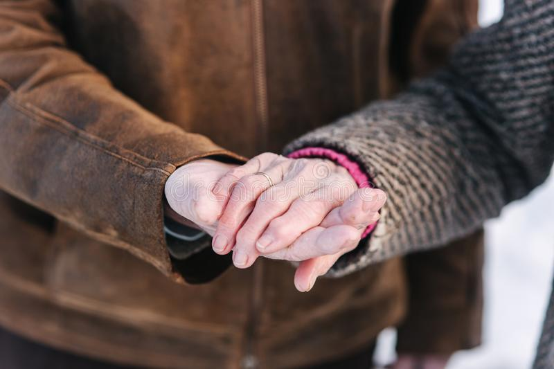 Closeup hands of seniors people. Male and female. Couple. Grandpa and grandma. Love forever. Closeup hands of seniors people. Male and female. Couple. Grandpa royalty free stock image