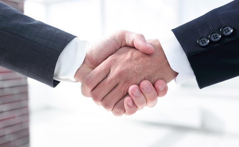 Closeup.handshake of business partners in office royalty free stock photo