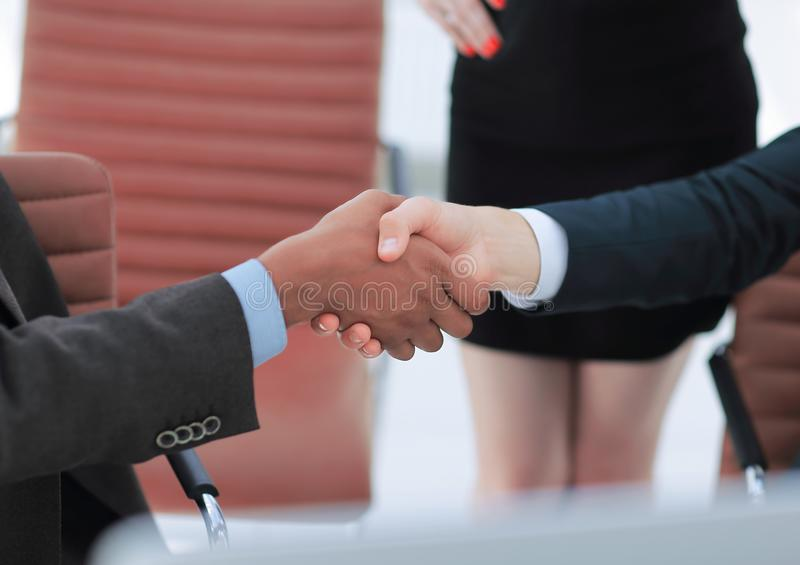 Closeup.handshake of business partners on the background of the office stock image
