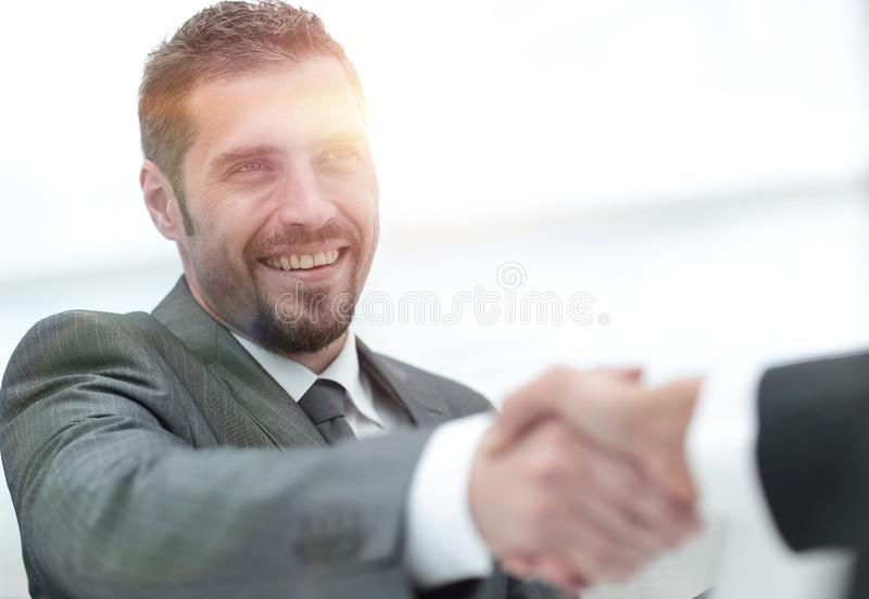 Closeup .handshake of business partners on a Desk royalty free stock photos