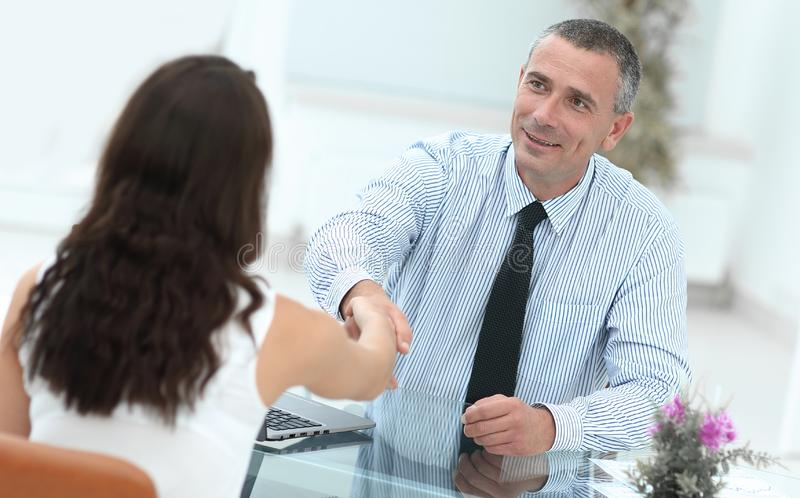 Closeup.handshake Manager and client. On the background of the office royalty free stock photos