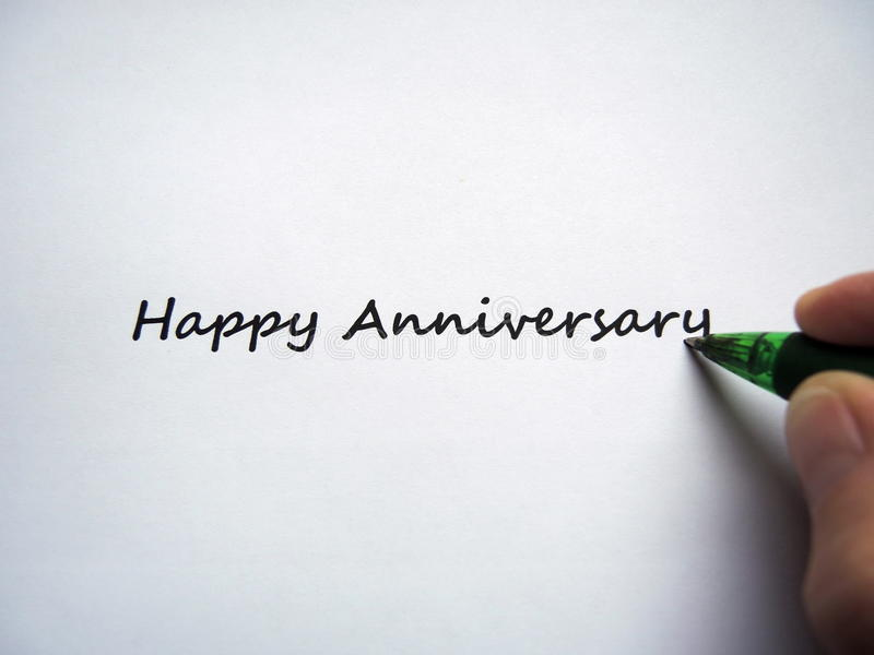 Closeup of a handwriting message Happy Anniversary. Closeup of a hand writing message Happy Anniversary stock photos