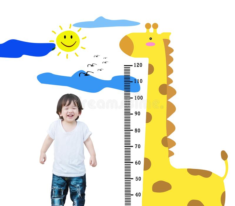 Closeup happy asian kid stand for measure height with cute cartoon isolated on white background. Closeup happy kid stand for measure height with cute cartoon stock images