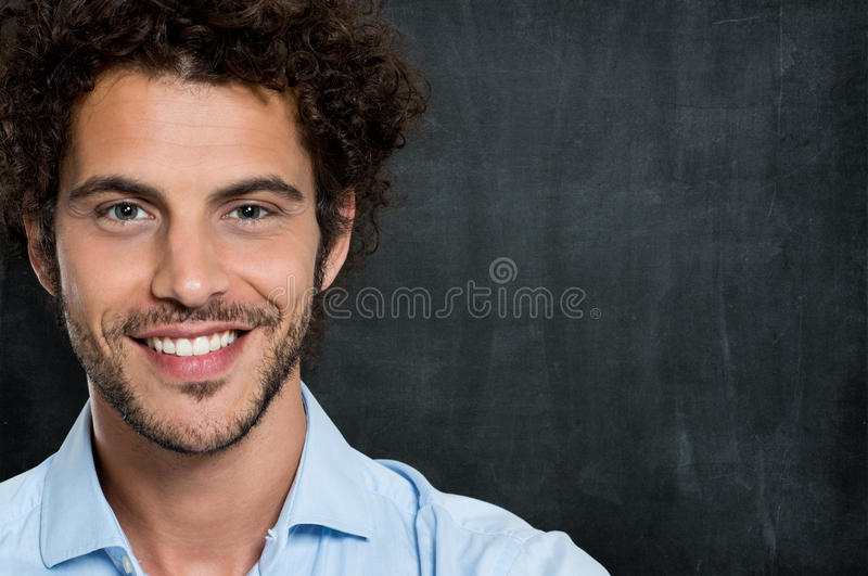 Closeup Of Happy Business man. Closeup Portrait Of Young Happy Man Over Gray Background stock photos