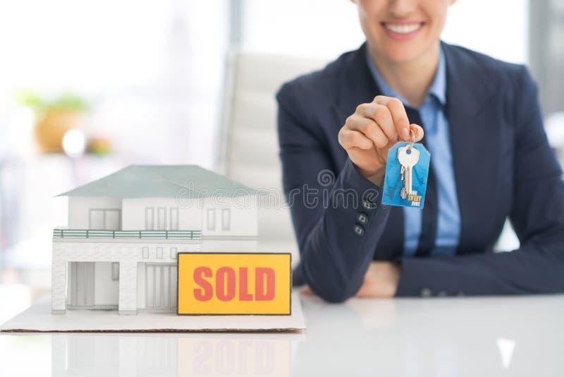 Closeup on happy realtor woman showing keys stock photos