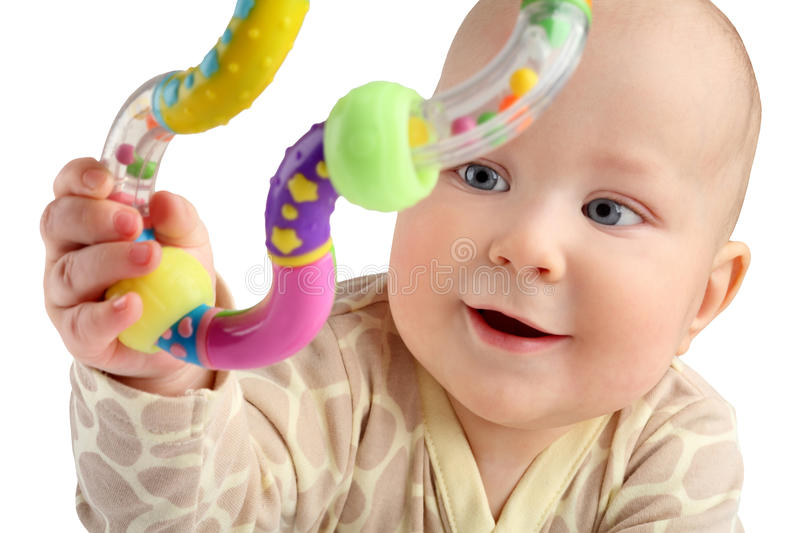 Closeup of happy seven months baby boy grabbing a toy isolated. stock photo