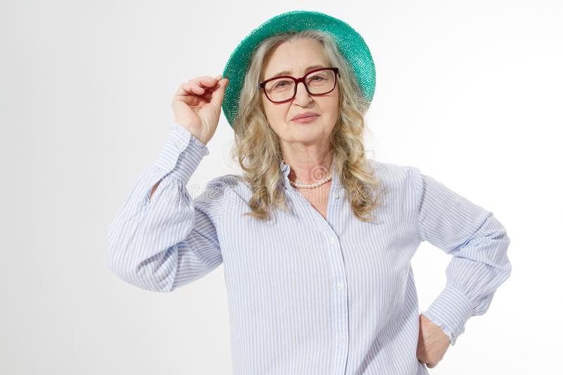 Closeup of happy stylish senior woman in business glasses and summer hat . Positive life living of elderly people. Healthy. Lifestyle and seniors fun time. Copy royalty free stock image