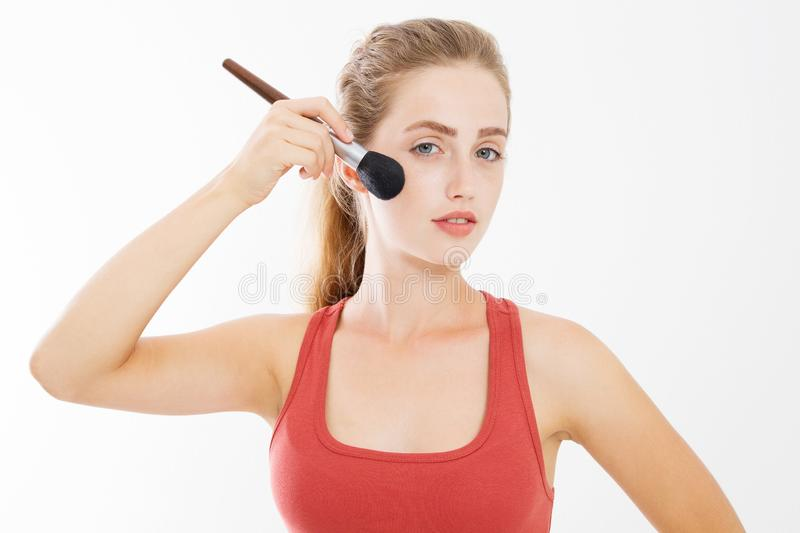 Closeup of happy young woman face with make up brush isolated on white background. Beauty girl skin care concept. Copy space royalty free stock image