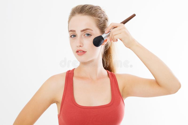 Closeup of happy young woman face with make up brush isolated on white background. Beauty girl skin care concept. Copy space stock photo