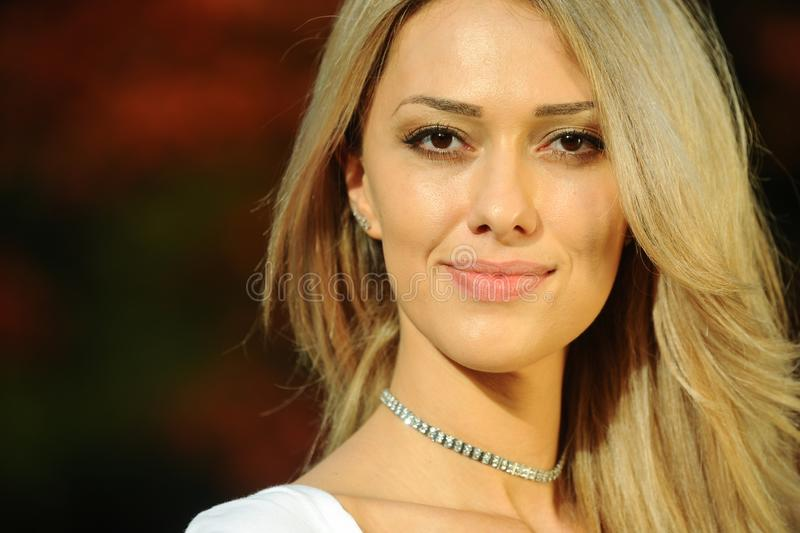 Closeup head shot of beautiful young brown eyed blond woman. stock photography
