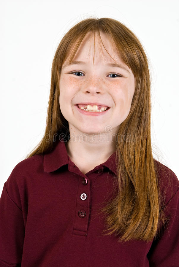 Young caucasion female in school shirt. A closeup, head and shoulders shot of a young female school child in a uniform polo shirt stock photos