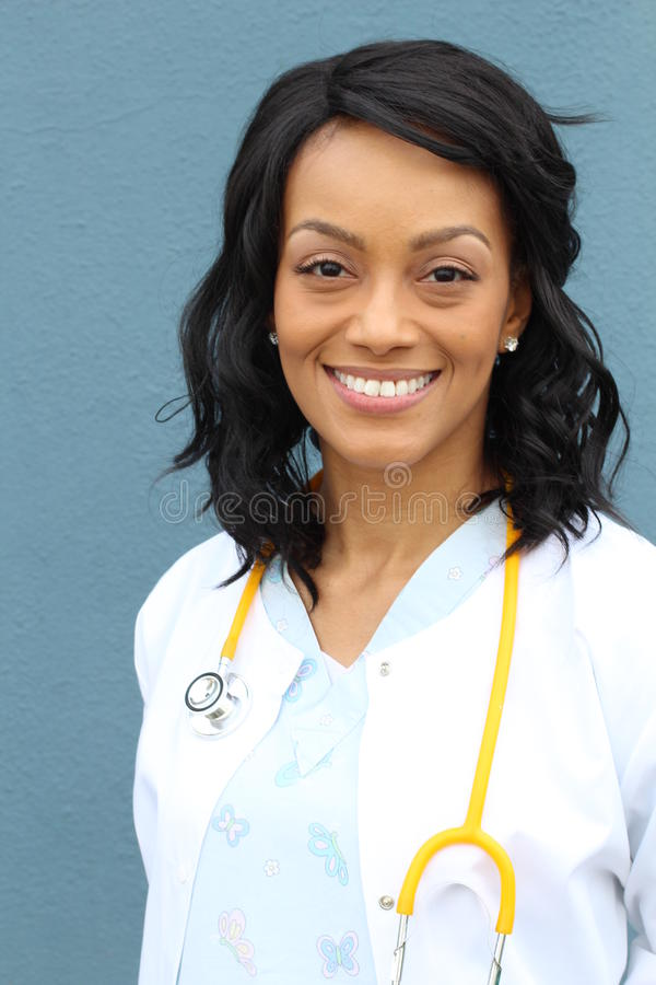 Closeup headshot portrait of friendly, smiling confident female African American healthcare professional with lab coat royalty free stock images