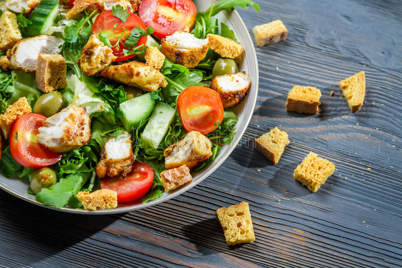 Closeup of healthy Caesar salad royalty free stock photography