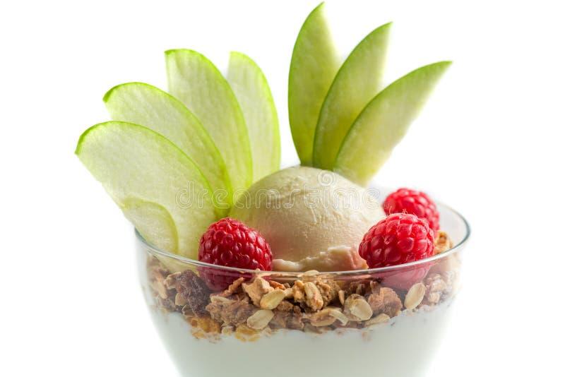 Closeup of healthy dessert with ice cream, raspberry and muesli royalty free stock photo