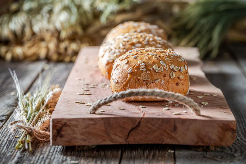 Closeup of healthy and fresh buns with oat flakes royalty free stock photos