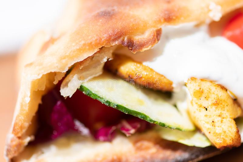 Closeup of healthy grilled chicken sandwich with homemade baguette royalty free stock image
