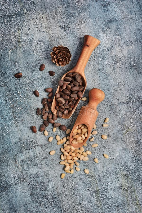 Closeup on healthy and tasty pine nuts in small wooden different scoop with cedar bump stock images