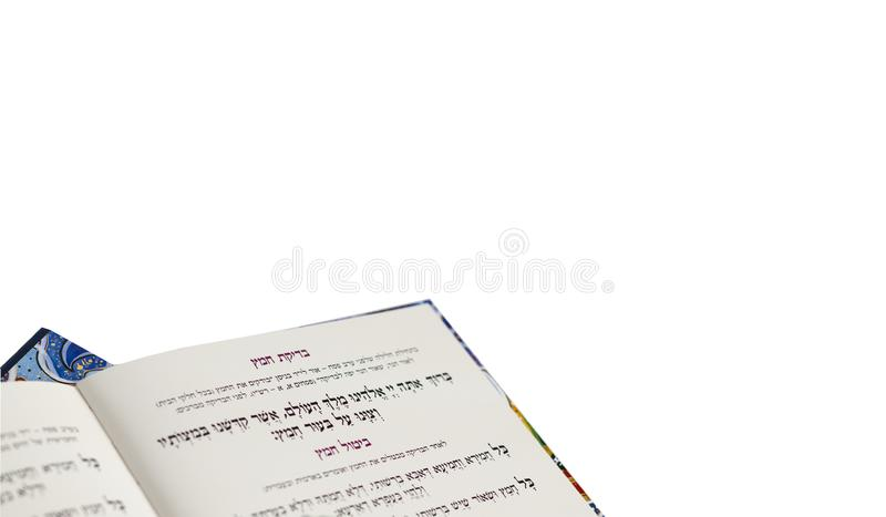 Passover Haggadah `Eliminating the Leaven`- Judaica Related Isolated on White Background. Closeup of Hebrew text in traditional Passover Haggadah `Eliminating stock image