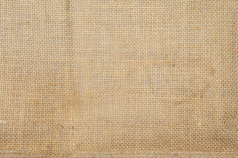 Closeup hessian fabric texture background, blank brow fiber pattern background. Natural color fiber stock image