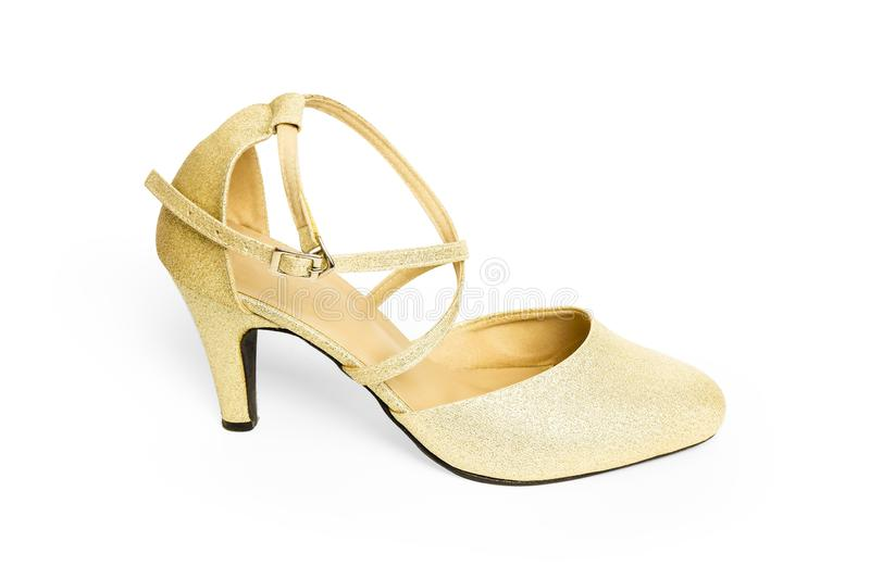 Closeup High Heel in Shining Golden Color Shoes Woman with Ankle Strap. Single Gold Women Shoe for fashionable. Beautiful Luxury H. Igh Heels on White Background royalty free stock image