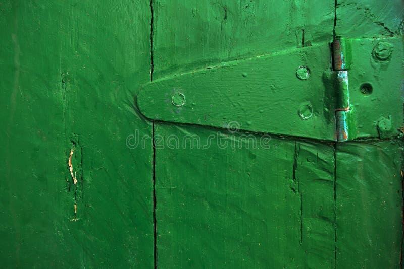 Closeup of hinge on an old door stock photo