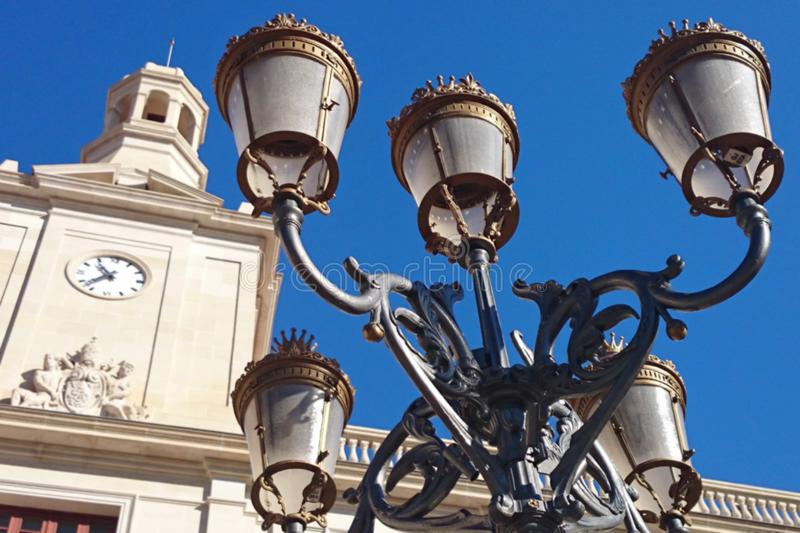 Closeup of historic street lamp in front of the town hall of Reus on the Plaça del Mercadal, Tarragona province, Spain, Europe. Reus is not only the birthplace royalty free stock images
