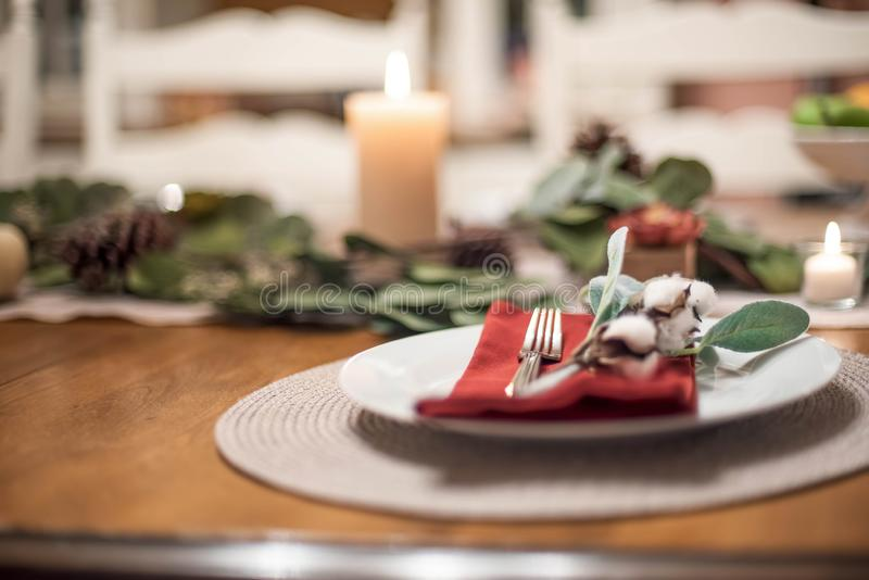 Thanksgiving place setting using greens and natural cotton stems stock photos