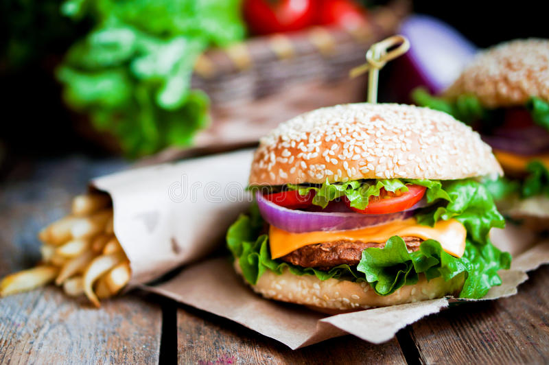 Closeup of home made burgers on wooden background stock photos