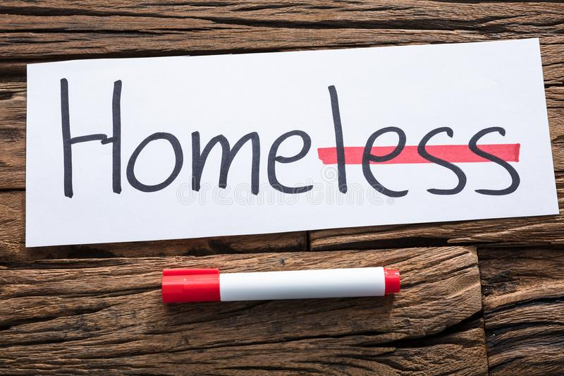Homeless Text On Paper With Strike Out Less Word stock photo