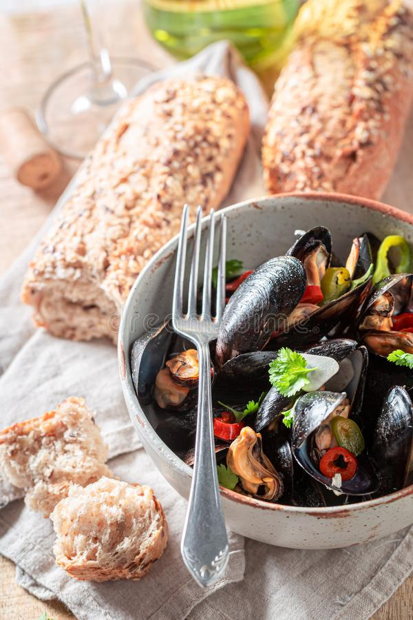 Closeup of homemade mussels with garlic and fresh coriander royalty free stock photography