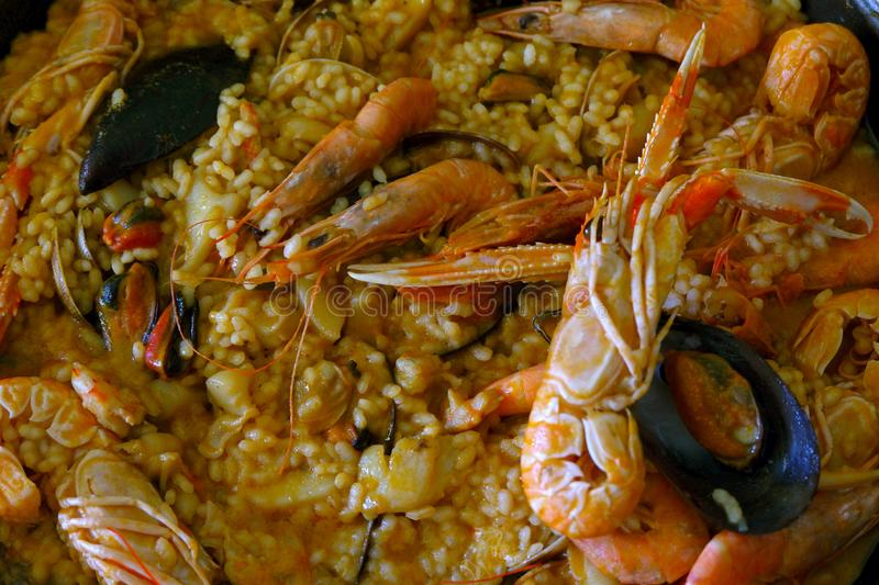Closeup of homemade paella - a traditional Spanish rice dish with seafood. Closeup of homemade paella - a traditional Spanish rice bomba variety dish with stock photos
