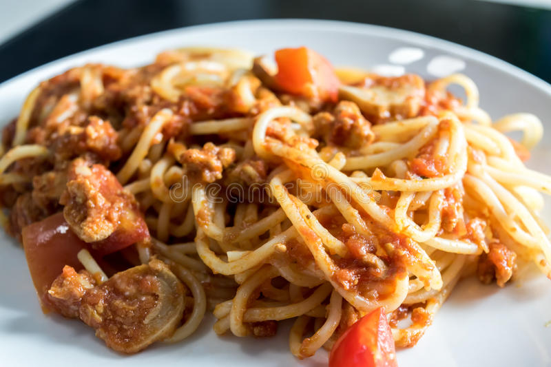 Closeup homemade spagetti with italian red sauce on plate. Selective focus royalty free stock photo