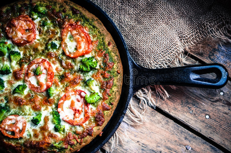 Closeup of homemade vegetarian pizza on wooden background royalty free stock photo