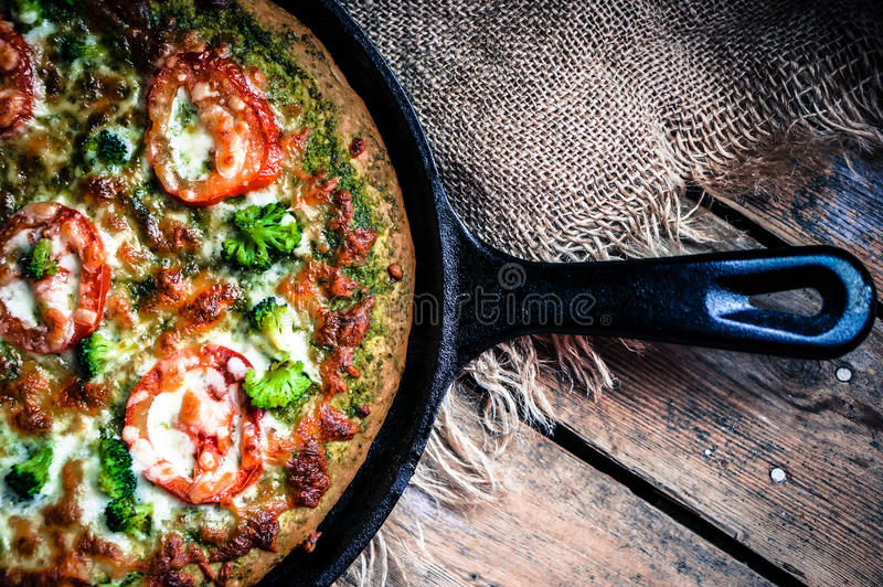 Closeup of homemade vegetarian pizza on wooden background stock image