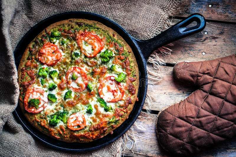 Closeup of homemade vegetarian pizza on wooden background stock photography