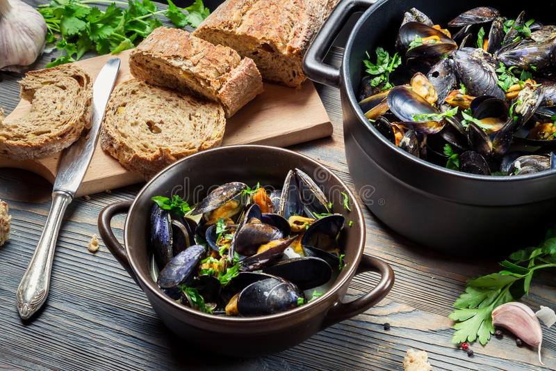 Closeup of homemade way of serving mussels royalty free stock images