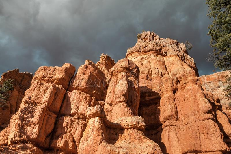 Closeup Of Hoodoo Rocks And Dramatic Sky Near Red Canyon royalty free stock photography