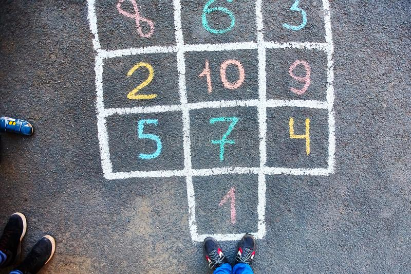Closeup of hopscotch drawn with chalk on asphalt road. Children royalty free stock image