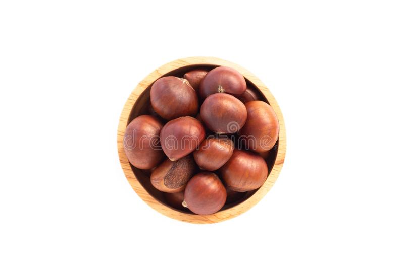 Closeup horse chestnuts in wood bowl isolated on white background,  healthy food concept. Closeup horse chestnuts in wood bowl isolated on white background royalty free stock photos