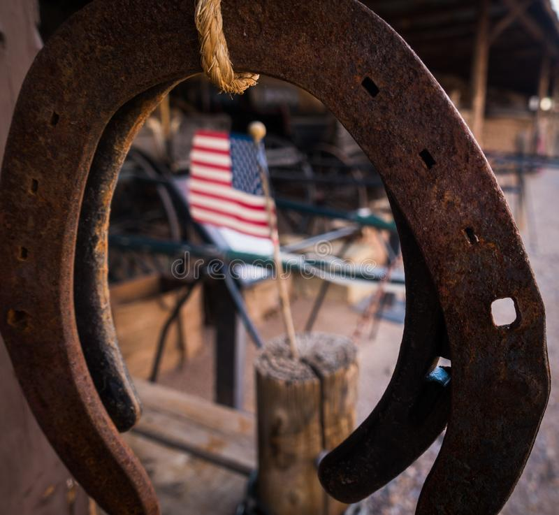Closeup of horseshoe with american flag in background royalty free stock photo