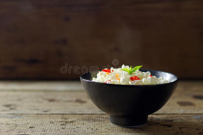 Closeup of hot instant noodles with smokes. Background royalty free stock photography