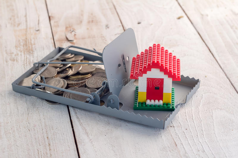 Closeup of house model on mousetrap royalty free stock photography