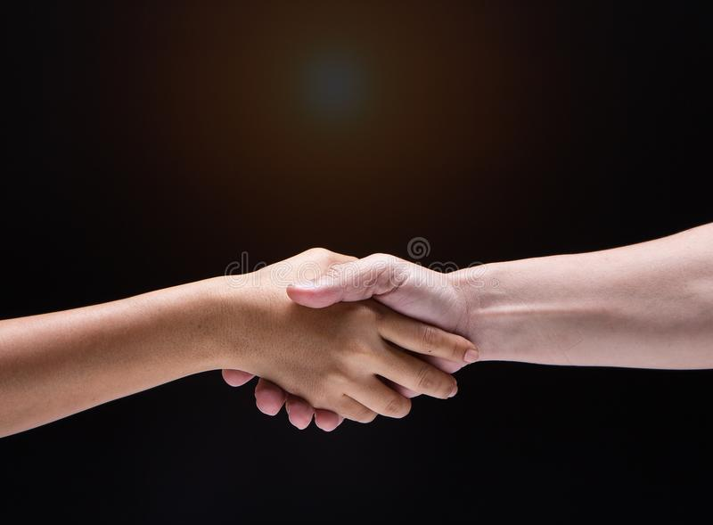 Closeup human hand touch together.They are shaking hand to be sign for trust and teamwork royalty free stock images