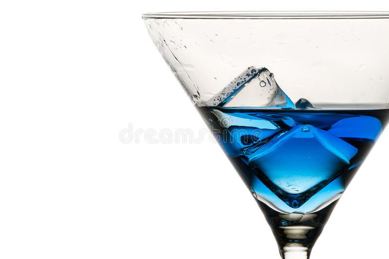 Closeup ice cubes with drops in martini glass royalty free stock images
