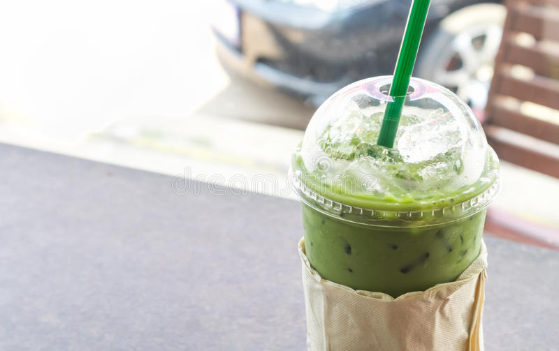 Closeup Ice of matcha latte in plastic glass take away cup, selective focus stock photography
