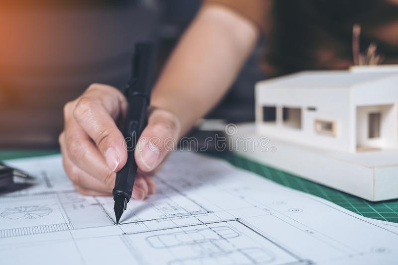 Closeup image of architects drawing shop drawing paper with mass model. On table royalty free stock photography