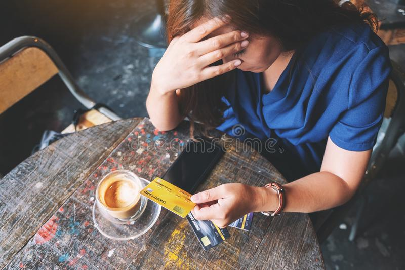 An Asian woman get stressed and broke while holding credit card stock images